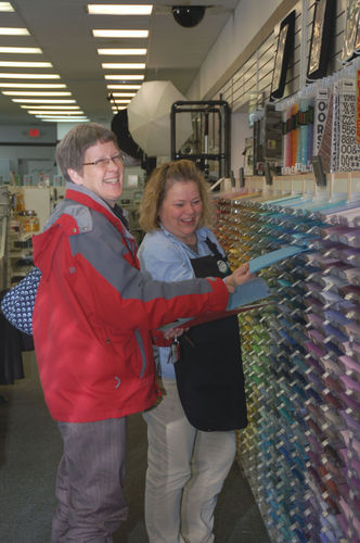 Vicki helping a customer with color selection on card stock